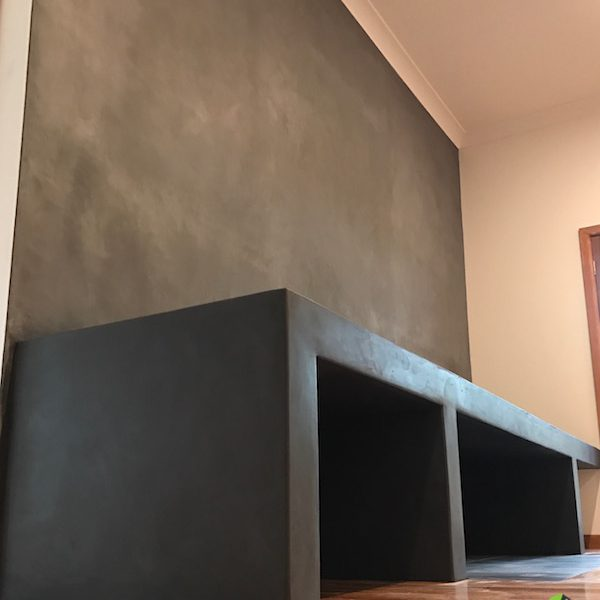 Sleek and Stylish Fireplace using a dark concrete look Tadelakt